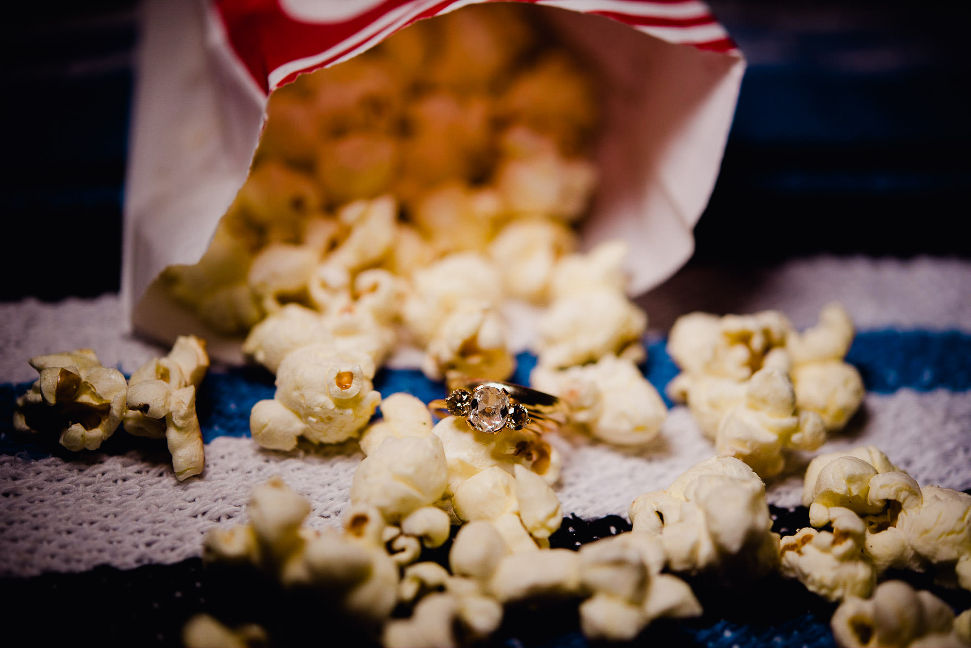 bell and bird engagement ring, ring detail shot on popcorn, creative engagement ring photo