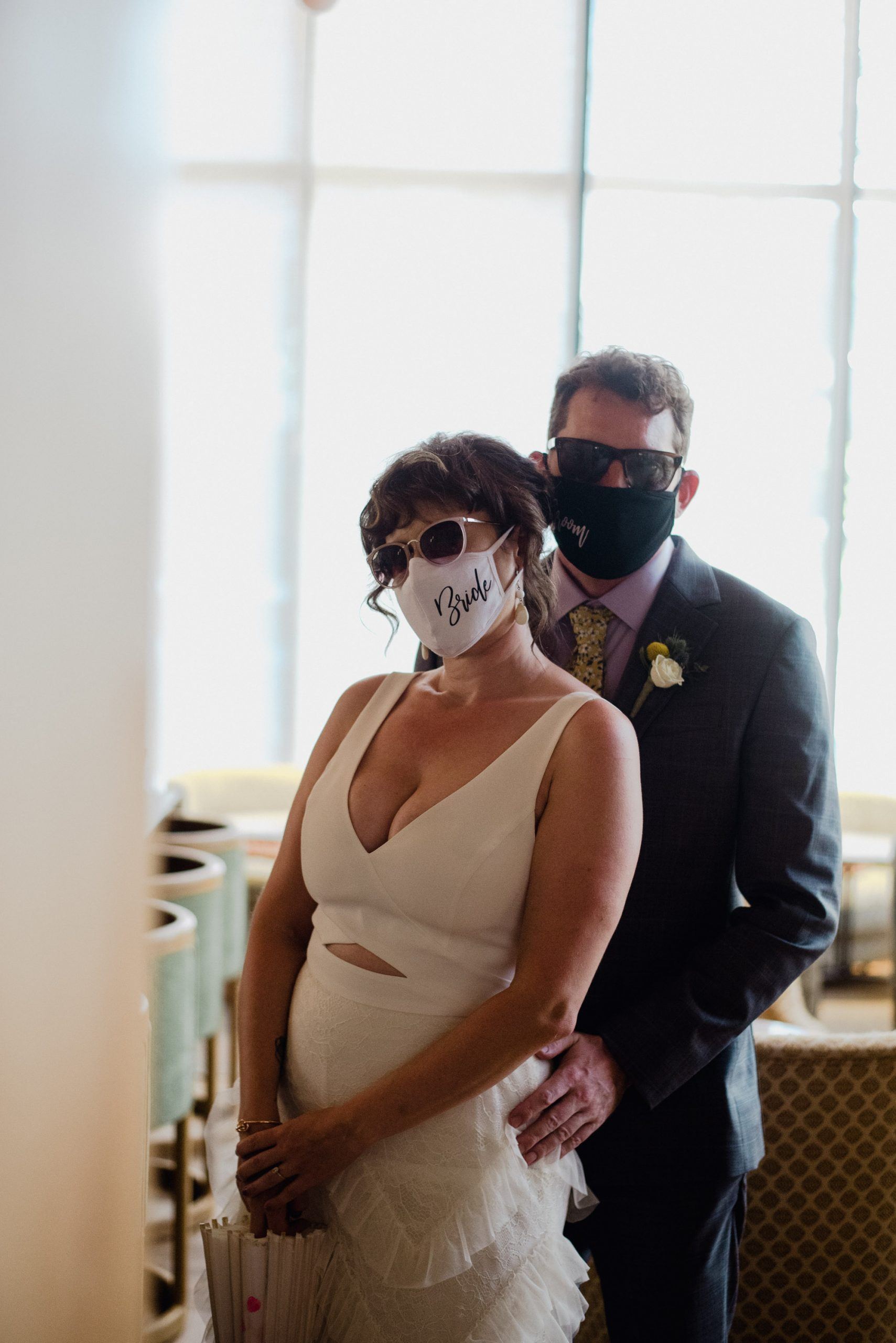 bride and groom wearing masks, covid wedding, austin wedding during pandemic, bride and groom portraits wearing a mask