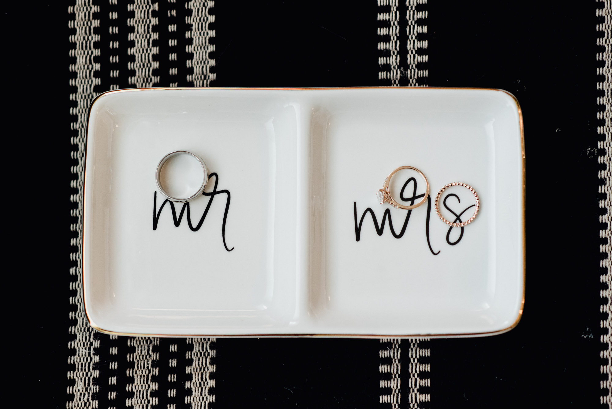 ring details on a mr and mrs tray at an austin restaurant elopement
