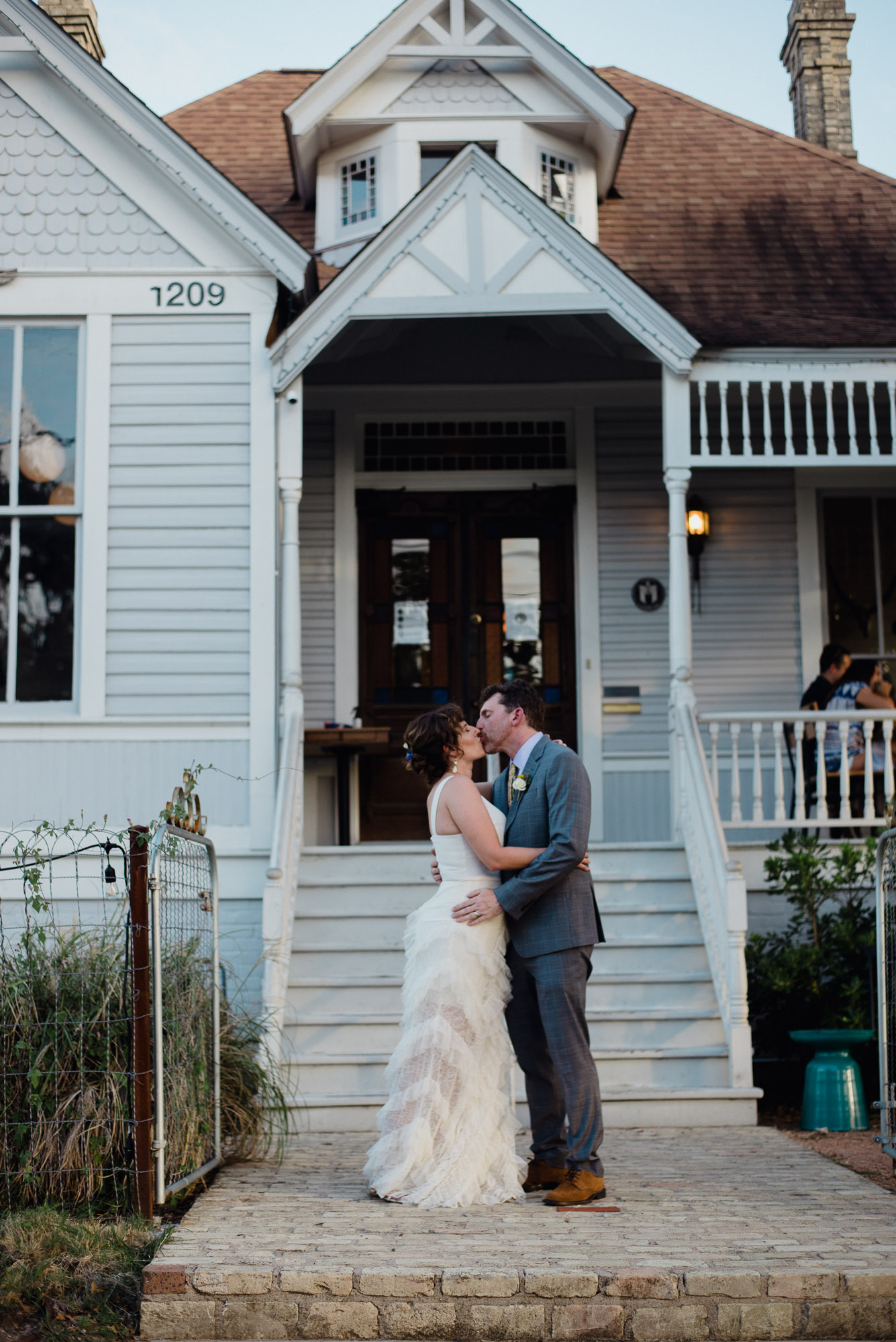 bride and groom photos outside Rosewood Austin